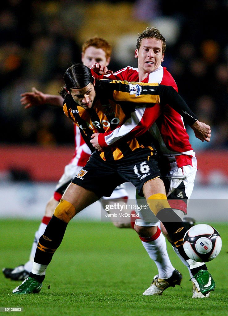 Peter Halmosi of Hull battles with Brian Howard of Sheffield United during the FA Cup sponsored by E.on, 5th round replay match between Hull City and Sheffield United at the KC Stadium on February 26, 2009 in Hull, England.