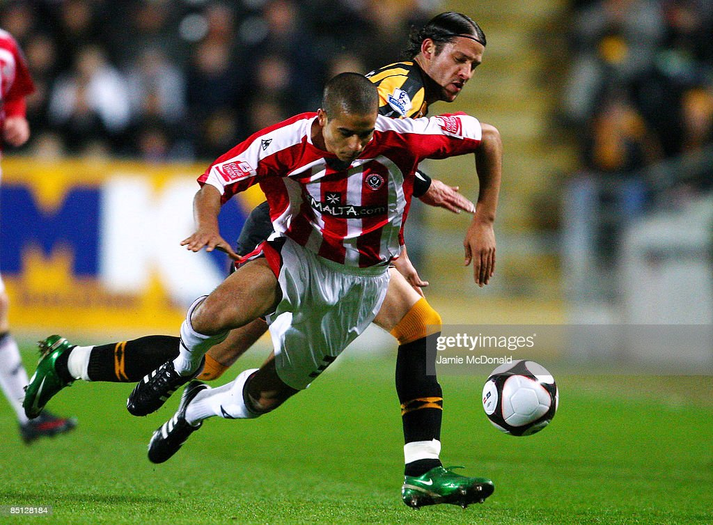 Peter Halmosi (R) of Hull battles with Kyle Naughton of Sheffield United during the FA Cup sponsored by E.on 5th round replay match between Hull City and Sheffield United at the KC Stadium on February 26, 2009 in Hull, England.