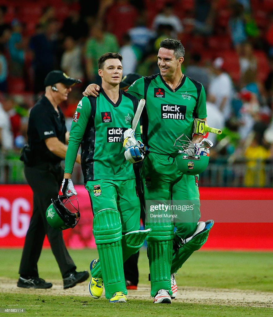 Peter Handscomb and Kevin Pietersen of the Stars smile after winning the Big Bash League match between the Sydney Thunder and the Melbourne Stars at Spotless Stadium on January 17, 2015 in Sydney, Australia.