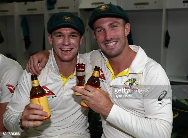 Peter Handscomb and Shaun Marsh of Australia celebrate in the changerooms after Australia regained the Ashes during day five of the Third Test match...