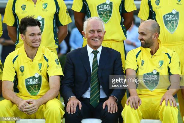 Peter Handscomb Australian Prime Minister Malcom Turnbull and Nathan Lyon chat during a team photo before the One Day Tour Match between the Prime...