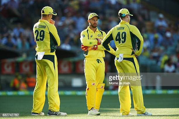 Peter Handscomb Matthew Wade and Steve Smith of Australia stand in the field during game five of the One Day International series between Australia...