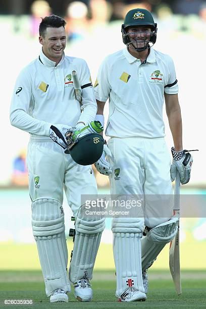 Peter Handscomb of Australia and Matthew Renshaw of Australia celebrate winning the match during day four of the Third Test match between Australia...