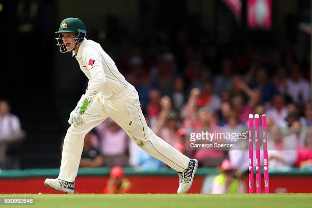 Peter Handscomb of Australia celebrates running out Azhar Ali of Pakistan off a delivery by team mate Nathan Lyon during day three of the Third Test...