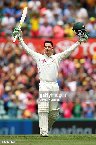 Peter Handscomb of Australia celebrates scoring a century during day two of the Third Test match between Australia and Pakistan at Sydney Cricket...