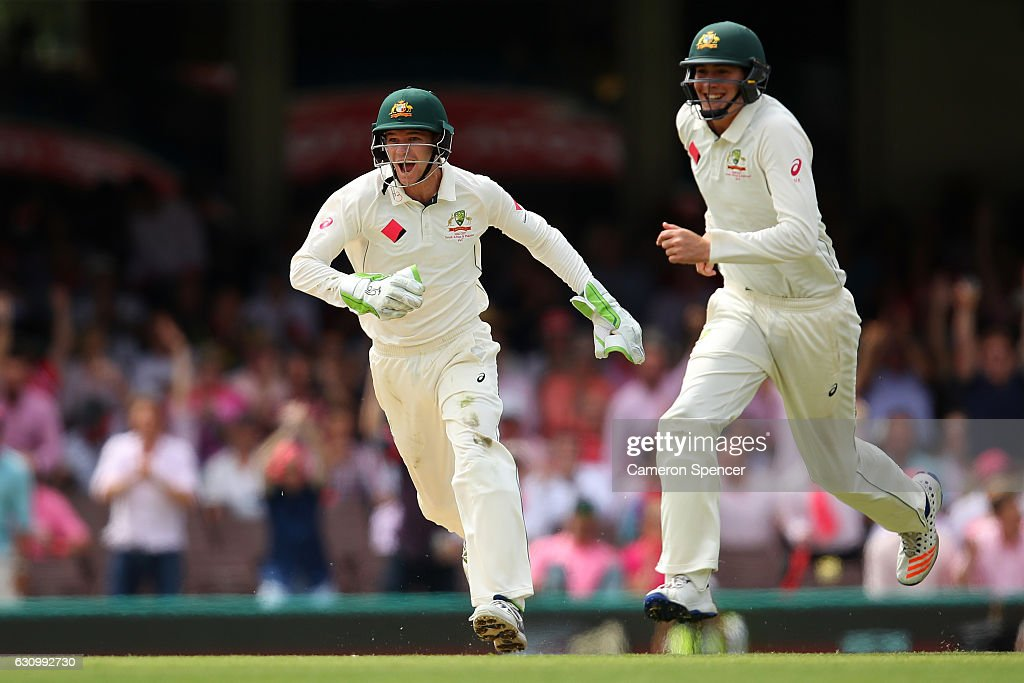 Peter Handscomb of Australia celebrates with team mate Matt Renshaw of Australia after running out Azhar Ali of Pakistan off a delivery by Nathan Lyon of Australia during day three of the Third Test match between Australia and Pakistan at Sydney Cricket Ground on January 5, 2017 in Sydney, Australia.