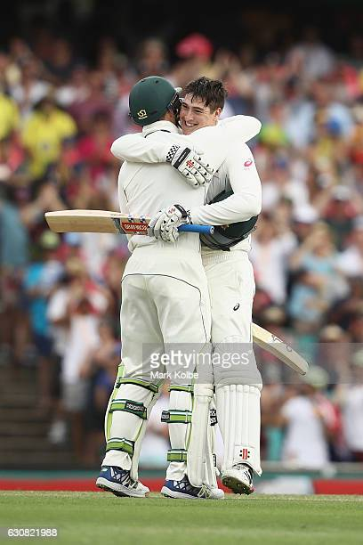 Peter Handscomb of Australia congratulates Matt Renshaw of Australia as celebrates his century during day one of the Third Test match between...