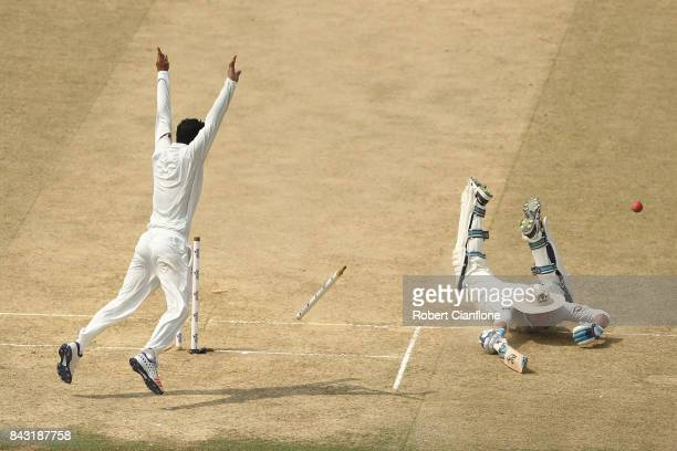 Peter Handscomb of Australia is run out by a throw from Shakib Al Hasan of Bangladesh during day three of the Second Test match between Bangladesh...