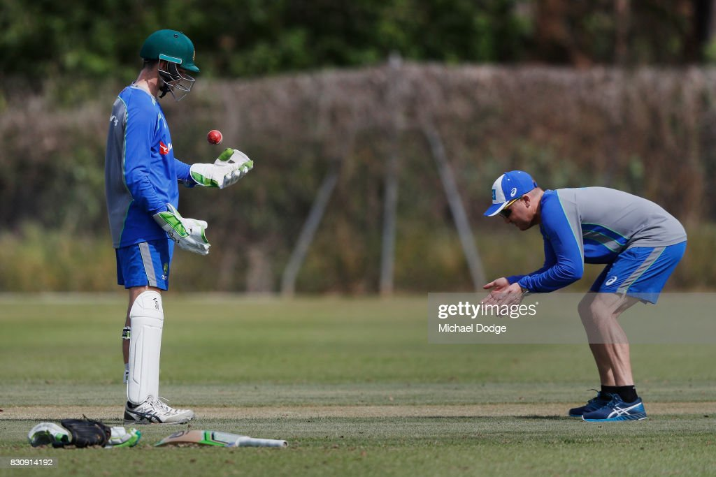 Peter Handscomb of Australia listens to keeping tips from Brad Haddin during an Australia Test cricket squad training session at Marrara Cricket Ground on August 13, 2017 in Darwin, Australia.