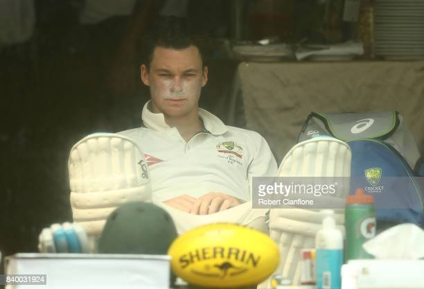 Peter Handscomb of Australia looks on from the dressing room during day two of the First Test match between Bangladesh and Australia at Shere Bangla...