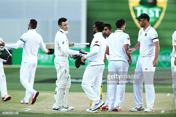 Peter Handscomb of Australia shakes hands with South African players after winning the test on day four of the Third Test match between Australia and...