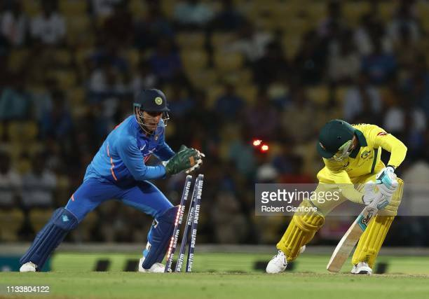 Peter Handscomb of Australia survise a stumping from MS Dhoni of India during game two of the One Day International series between India and...