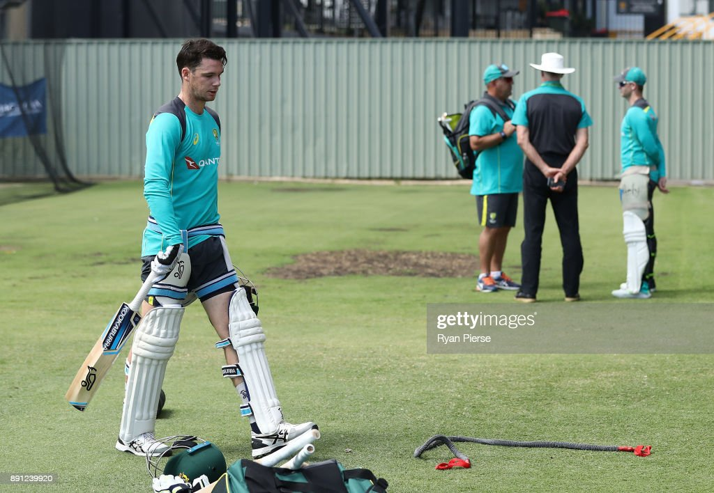 Peter Handscomb of Australia walks from the nets as Australian Head Coach Darren Lehmann, Australian Selector Greg Chappell and Steve Smith of Australia talk during an Australian nets session ahead of the Third Test of the 2017/18 Ashes Series at the WACA on December 13, 2017 in Perth, Australia.