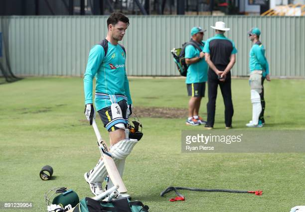 Peter Handscomb of Australia walks from the nets as Australian Head Coach Darren Lehmann Australian Selector Greg Chappell and Steve Smith of...