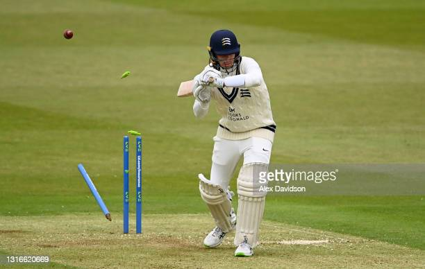 Peter Handscomb of Middlesex is bowled with out playing a shot by David Payne of Gloucestershire during Day One of the LV= Insurance County...