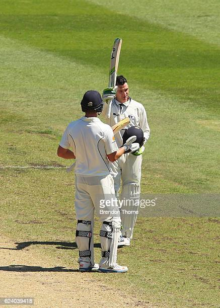 Peter Handscomb of the Bushrangers celebrates scoring his double century during day two of the Sheffield Shield match between New South Wales and...