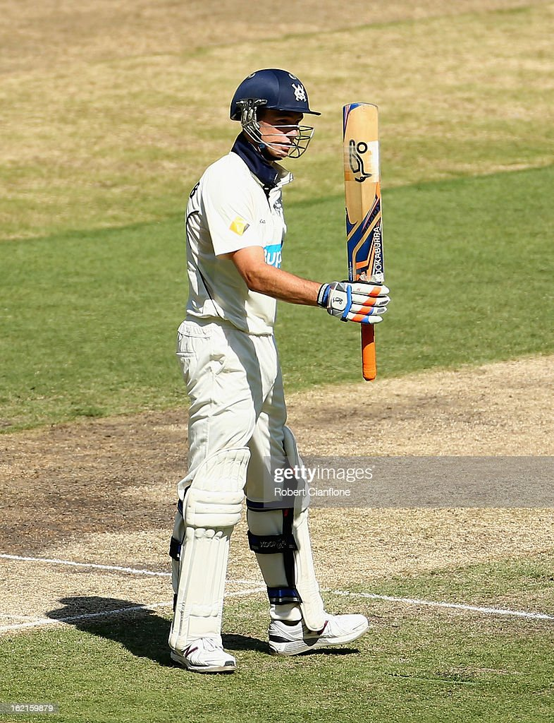 Peter Handscomb of the Bushrangers raises his bat after scoring his half century during day three of the Sheffield Shield match between the Victorian Bushrangers and Queensland Bulls at the Melbourne Cricket Ground on February 20, 2013 in Melbourne, Australia.