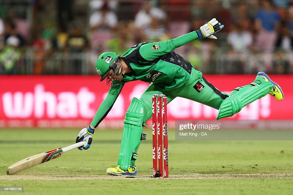 Peter Handscomb of the Stars slides in to avoid a runout during the Big Bash League match between the Sydney Thunder and the Melbourne Stars at Spotless Stadium on January 17, 2015 in Sydney, Australia.