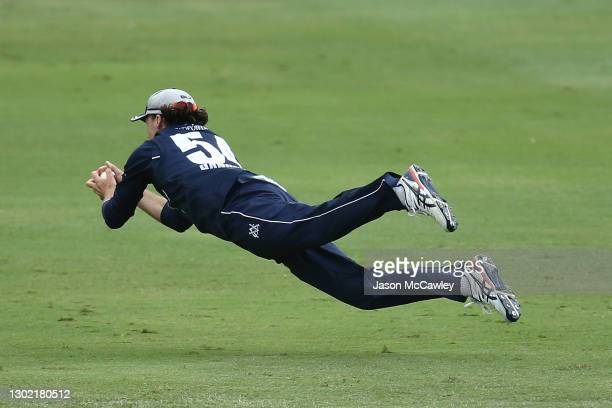 Peter Handscomb of Victoria catches Sean Abbott of the Blues during the Marsh One Day Cup match between New South Wales and Victoria at North Sydney...