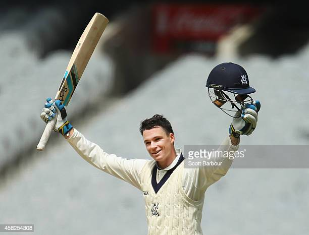 Peter Handscomb of Victoria celebrates as he reaches his century during day three of the Sheffield Shield match between Victoria and New South Wales...