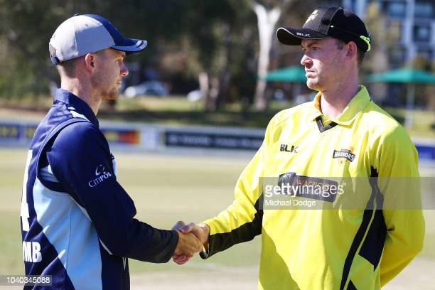 Peter Handscomb of Victoria shakes hands Ashton Turner of Western Australia after the coin toss during the JLT One Day Cup between Victoria and...