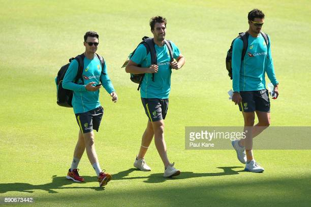Peter Handscomb Pat Cummins and Mitchell Starc of Australia walk to th eplayers rooms before an Australian Nets Session ahead of the Third Test in...