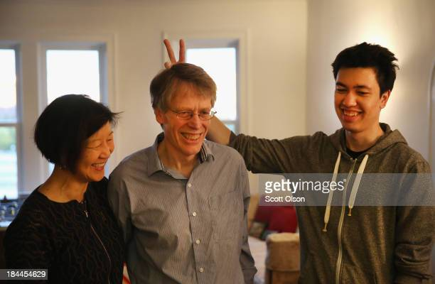 Peter Hansen plays around with his father University of Chicago professor Lars Peter Hansen and mother Grace Tsiang while posing for a picture after...