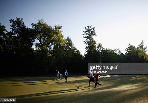 Peter Hanson and Hank Kuehne walk down the 10th fairway during the first round of the Zurich Classic of New orleans at TPC Louisiana on April 26,...