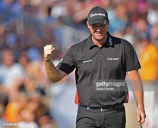 Peter Hanson of Sweden celebrates holeing his eagle putt on the 18th hole during the final round of the KLM Open at Hilversumsche Golf Club on...