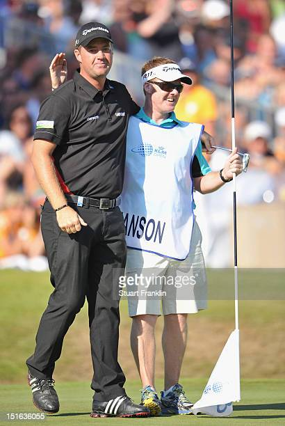 Peter Hanson of Sweden celebrates holeing his eagle putt on the 18th hole with his caddie Woody during the final round of the KLM Open at...