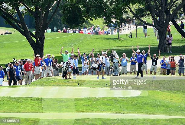 Peter Hanson of Sweden celebrates on the tee after making a holeinone on the second hole during the third round of the Quicken Loans National at...