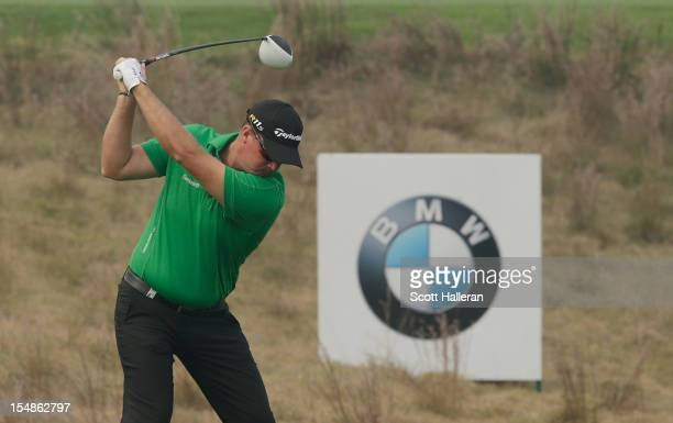 Peter Hanson of Sweden hits his tee shot on the ninth hole during the final round of the BMW Masters at the Lake Malaren Golf Club on October 28,...