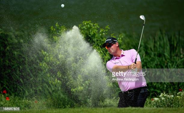 Peter Hanson of Sweden plays a bunker shot during the last 16 matches on Day Three of the Volvo World Match Play Championship at Thracian Cliffs Golf...