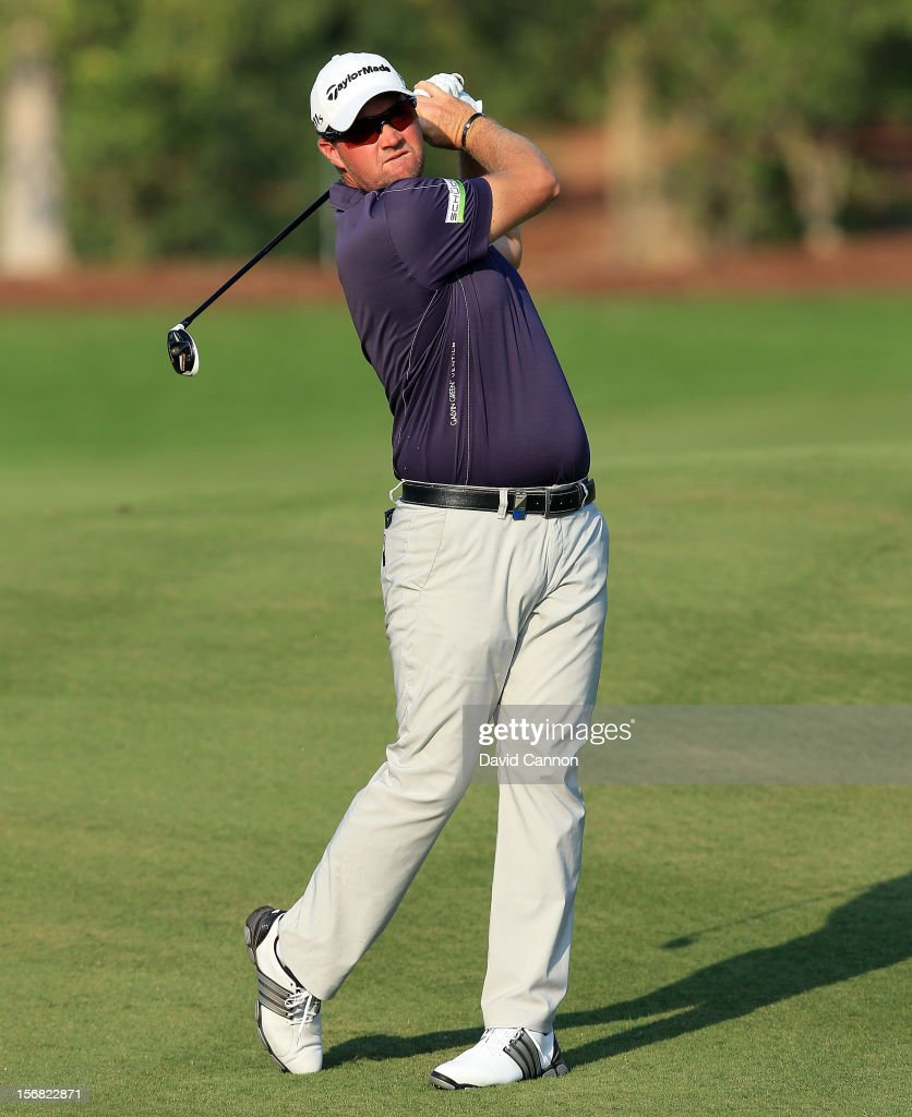 Peter Hanson of Sweden plays his second shot on the par five 15th hole during the first round of the 2012 DP World Tour Championship on the Earth Course at Jumeirah Golf Estates on November 22, 2012 in Dubai, United Arab Emirates.