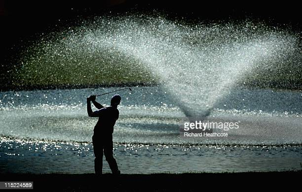 Peter Hanson of Sweden plays into the 18th green during the third round of the Saab Wales Open on the Twenty Ten course at The Celtic Manor Resort on...