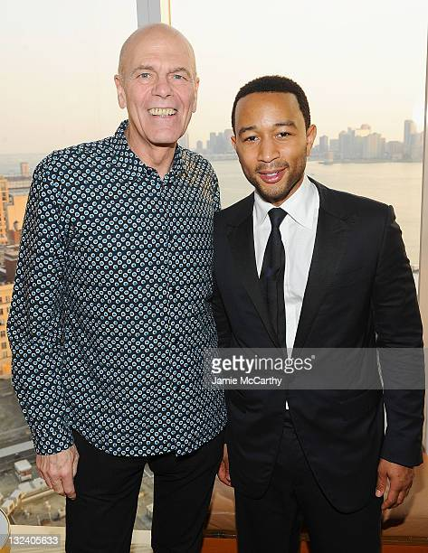 Peter Harf Chairman of Coty Inc and musician John Legend attend the GUESS Seductive Fragrance launch at The Top of The Standard on June 8 2011 in New...