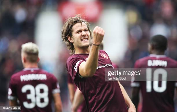 Peter Haring of Heart of Midlothian celebrates scoring the opening goal during the Ladbrokes Premiership match between Heart of Midlothian and St...
