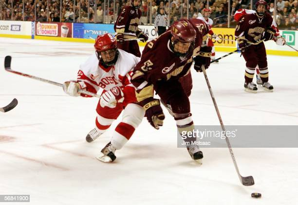 Peter Harrold of the Boston College Eagles controls the puck against Brad Zancanaro of the Boston University Terriers during the championship game of...