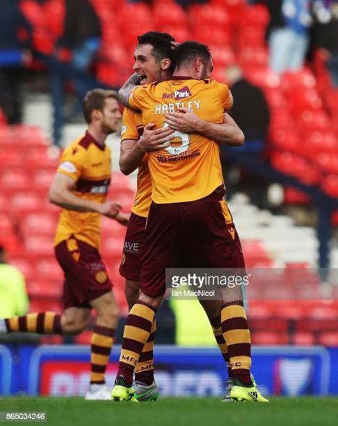 Peter Hartley and Carl McHugh of Motherwell reacts at full time during the Betfred League Cup Semi Final between Rangers and Motherwell at Hampden...
