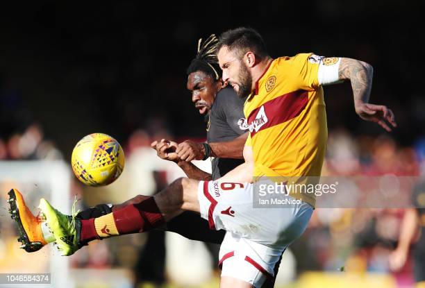 Peter Hartley of Motherwell vies with Dolly Menga of Livingston during the Ladbrokes Scottish Premiership match between Motherwell and Livingston at...