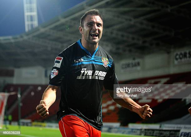 Peter Hartley of Stevenage celebrates scoring their second goal during the FA Cup Third Round match between Doncaster Rovers and Stevenage at the...