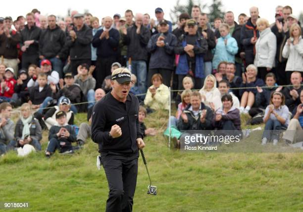 Peter Hedblom of Sweden celebrates after his final putt during the final round of the Johnnie Walker Championship on the PGA Centenary Course at...
