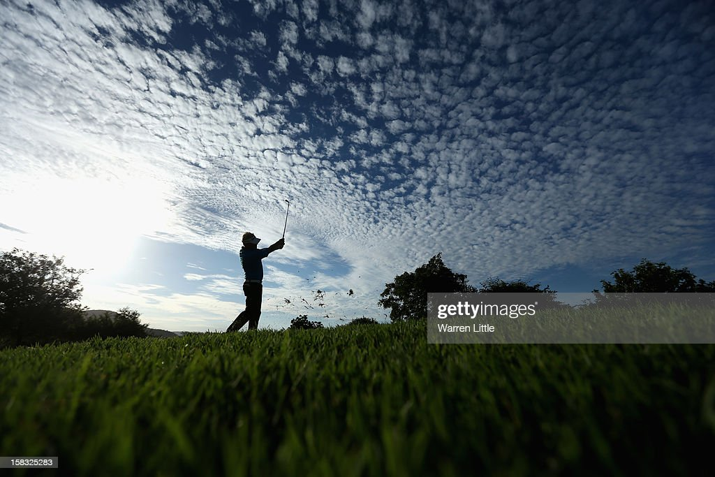 Peter Hedblom of Sweden plays his second shot into the 18th green during the first round of the Alfred Dunhill Championship at Leopard Creek Country Golf Club on December 13, 2012 in Malelane, South Africa.
