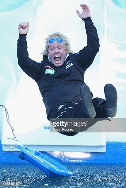 Peter Helliar dressed as Bryan Strauchan dives into an icebath to raise money for Motor Neurone Disease ahead of the round 10 AFL match between the...