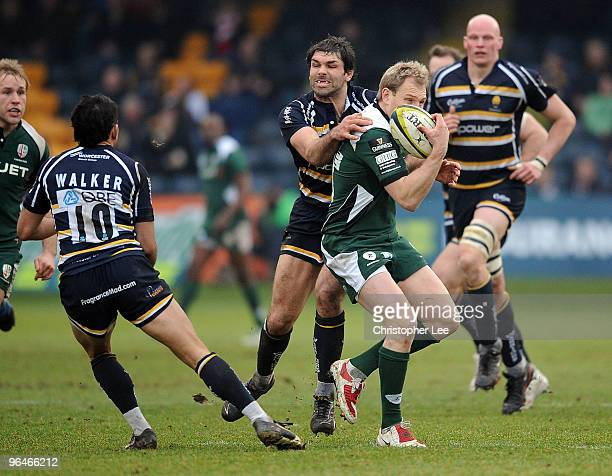 Peter Hewat of Irish tries to get away from Pat Sanderson of Worcester during the LV= Cup match between Worcester Warriors and London Irish at...
