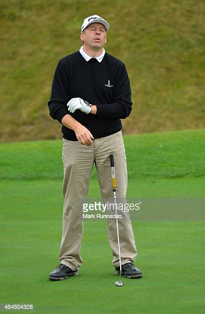 Peter Hewett of Woodhall Spa reacts on the 16th green during the first round of the Lombard Trophy Grand Final at Gleneagls on September 2 2014 in...