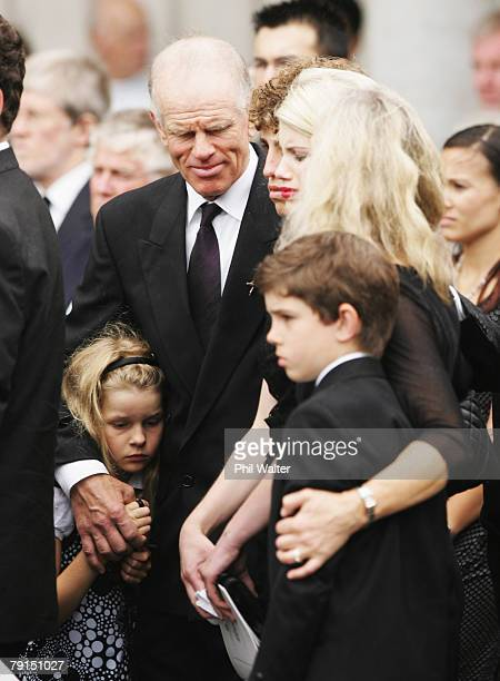 Peter Hillary stands with his grandchild Lily Louise as the hearse departs following the funeral service for Sir Edmund Hillary at St Marys Church on...