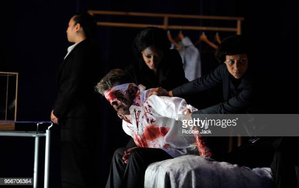 Peter Hoare as Mortimer with artists of the company in the Royal Opera's production of Martin Crimp's Lessons in Love and Violence directed by Katie...