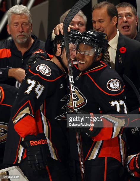 Peter Holland of the Anaheim Ducks is congratulated for his first career goal by teammate Devante SmithPelly of the Anaheim Ducks during the game on...