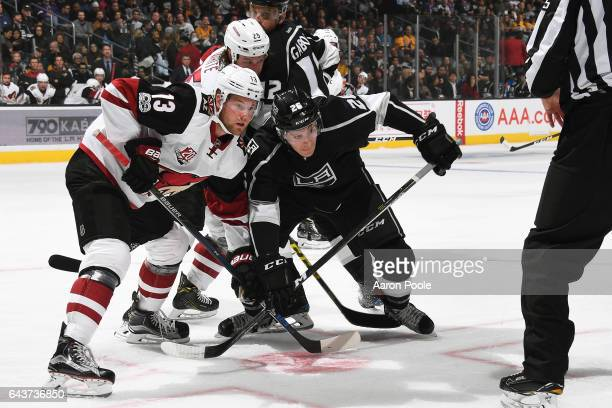 Peter Holland of the Arizona Coyotes battles for position against Nic Dowd of the Los Angeles Kings during the game on February 16 2017 at Staples...